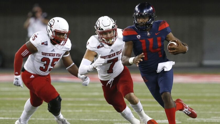 Arizona quarterback Khalil Tate (14) runs with the ball during the first half against Southern Utah in Tucson on Sept. 15.