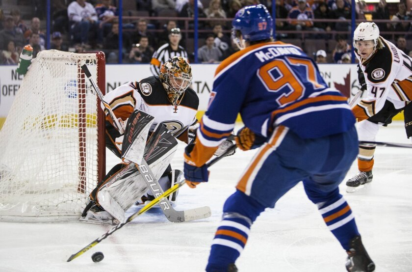 Anaheim Ducks' goalie Frederik Andersen (31) keeps his eye on the puck as Edmonton Oilers' Connor McDavid (97) looks for a shot during the second period of an NHL hockey game, Tuesday, Feb. 16, 2016 in Edmonton, Alberta. (Codie McLachlan/The Canadian Press via AP) MANDATORY CREDIT