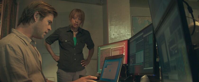 "Chris Hemsworth, left, plays Nicholas Hathaway and Viola Davis plays FBI Special Agent Carol Barrett in a scene from the movie ""Blackhat."""