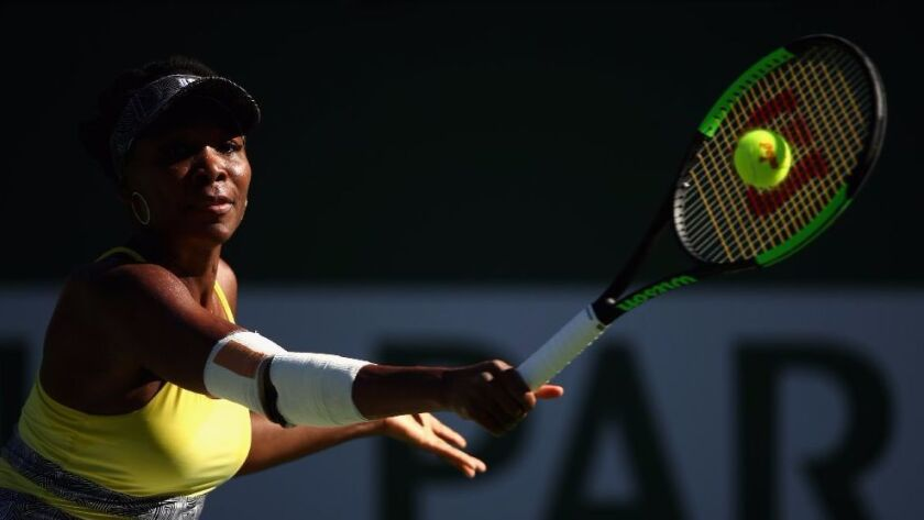 Venus Williams plays a backhand against Lucie Safarova in their third-round match during the BNP Paribas Open at Indian Wells Tennis Garden on March 13.