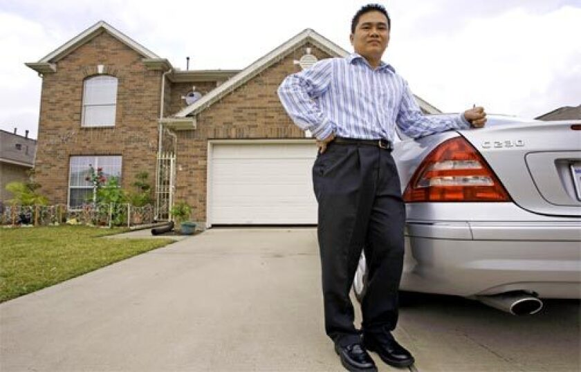 A RELATIVE BARGAIN: Vincent Ho, 36, bought this house in Houston for $175,000, which is three times larger than the El Monte house he sold for $600,000. He used the rest of the money to expand his Orange County-based business to the Texas city.