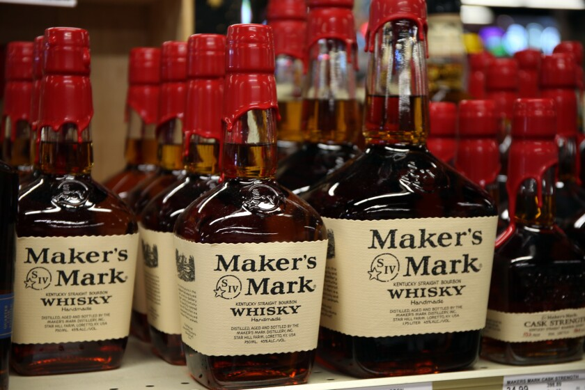 Bottles of Maker's Mark whiskey are seen in 2016 at a Binny's liquor store in Chicago's South Loop. The brand, owned by Beam Suntory, is benefiting from growth in American whiskey sales.