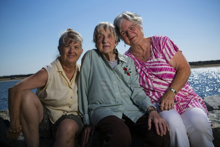 During a recent trip to Mission Bay, Gladys Smith (left) and her older sister Cheryl Jarvis (far right) gather near the water with their mother, Reva Randall, who has dementia. Jarvis is her mother's primary caregiver and Smith is executor of the estate. Nelvin C. Cepeda • U-T