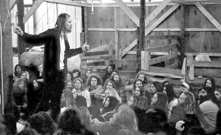 Stephen Gaskin, standing, explains his religious beliefs to gathering of his followers and some of the congregation of Sandy Hook Church of Christ at a joint meeting in Summertown, Tenn., in 1972.