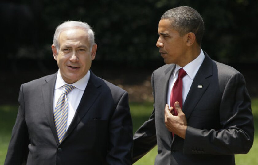 President Obama, seen with Israeli Prime Minister Benjamin Netanyahu, has confirmed he will travel to Israel this month.