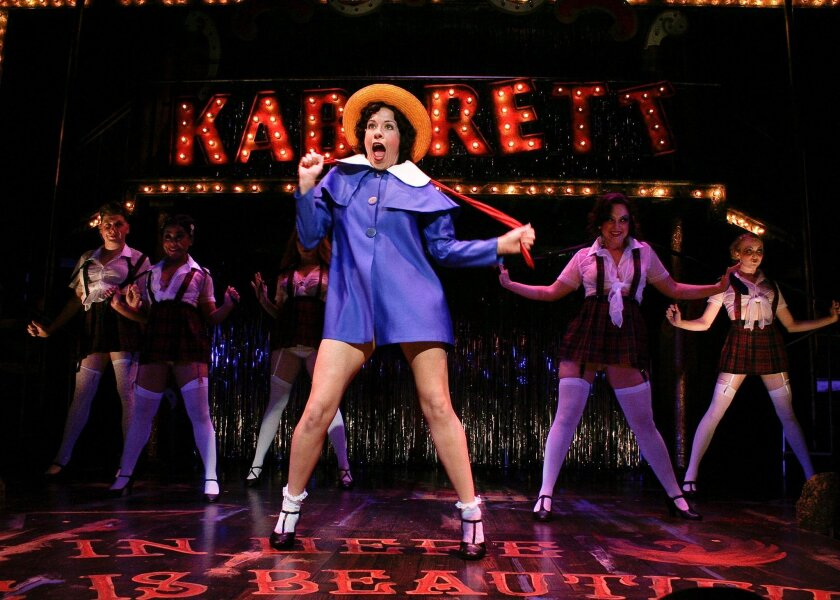 """Sally Bowles (Joy Yandell) leads the Kit Kat Girls of """"Cabaret"""" in the number """"Don't Tell Mama"""" at Cygnet Theatre."""