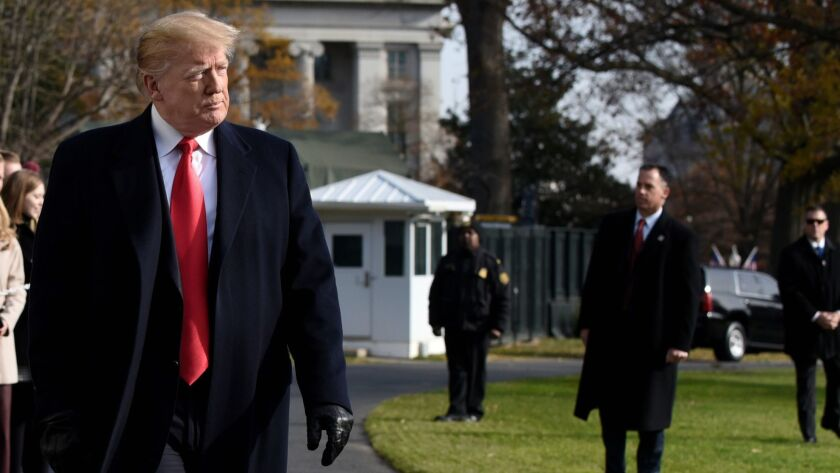 President Trump departs the White House on Dec. 8. Federal prosecutors say he directed hush-money payments to two women who said they had affairs with him years ago.