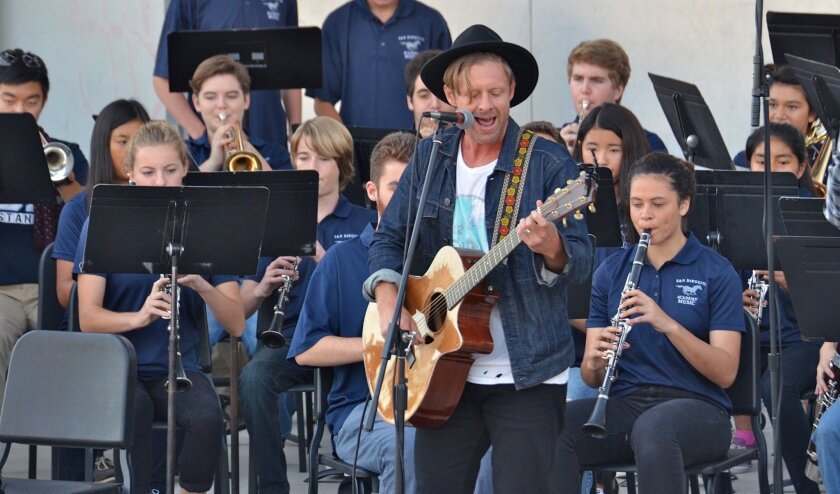 Jon Foreman of Switchfoot playing on Oct. 24 with the San Dieguito Academy Wind Ensemble at the school's outdoor amphitheater.