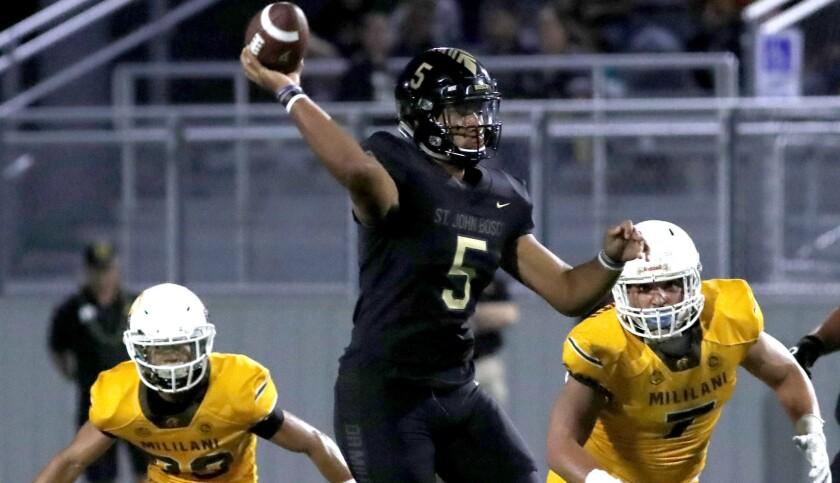 BELLFLOWER, CALIF. - AUG. 31, 2018. Bosco quarterback DJ Ulagalelei throws downfield against Milil