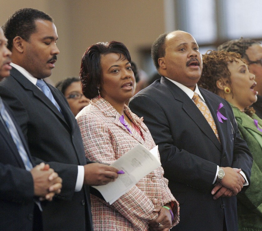 Dexter Scott King, left, Bernice King and Martin Luther King III are now working to resolve their differences out of court after the brothers dropped a lawsuit. A separate suit over their father's Bible and Nobel medal remains unresolved.