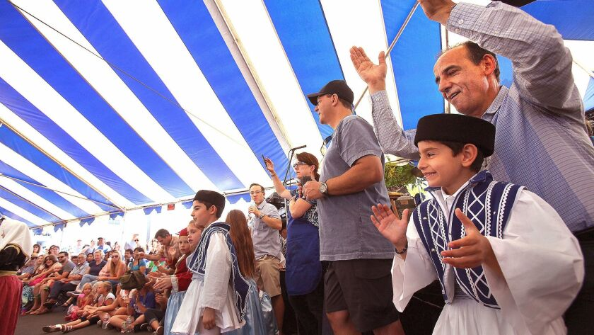 Greek dances being performed under the big tent at the annual Greek Festival at St. Spyridon Greek Orthodox Church.