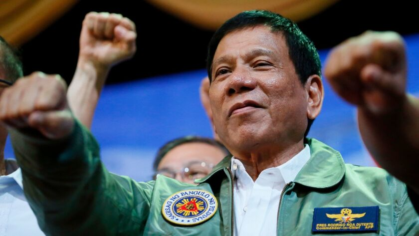 Philippines President Rodrigo Duterte poses with a fist bump last month during a ceremony at his nation's Air Force headquarters in the city of Pasay, southeast of Manila, Philippines.