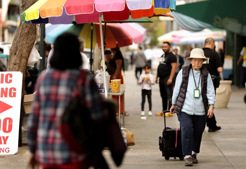 A senior woman in L.A.'s Chinatown