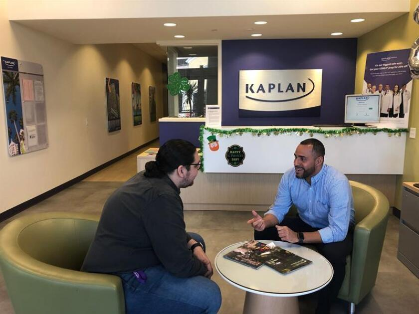 Nicaraguan doctor Anibal Munguia (l) speaks with Kaplan Study Center manager Julio Giron (r) on March 21, 2019, in Miami. EFE-EPA/Celeste Rodas de Juarez