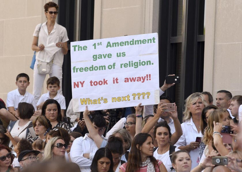 People protest New York's repeal of the religious exemption to vaccination in Albany on Aug. 14, 2019.