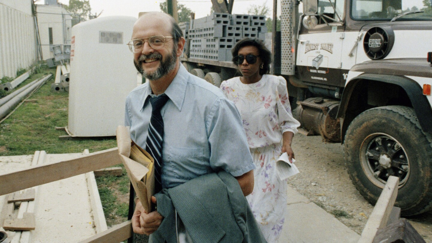 John A. Walker Jr. is escorted into the Montgomery County Detention Center in Rockville, Md., after a pretrial hearing in Baltimore in 1985.