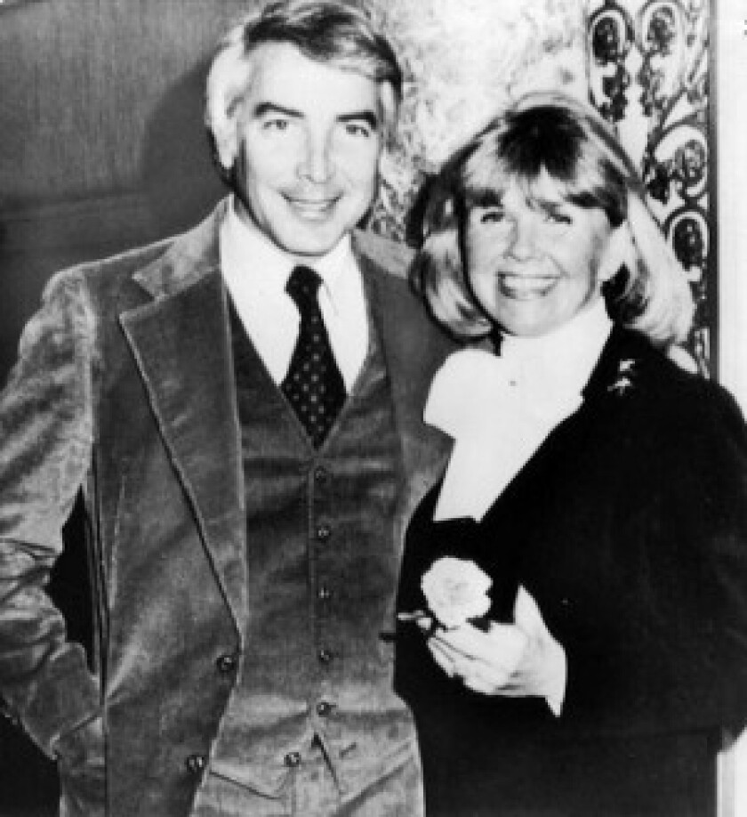Barry Comden, shown with Doris Day in 1976, helped form a company to distribute a line of pet foods with her name. The firm quickly folded.
