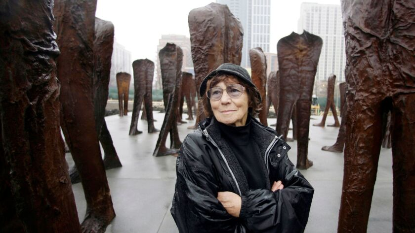 FILE - In this file photo taken Oct. 26, 2006, Polish sculptor Magdalena Abakanowicz stands before s