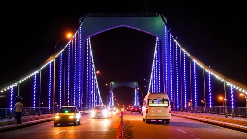 Cars cross the recently reopened 14th of July Bridge, a major thoroughfare linking Baghdad's banks across the Tigris River. The bridge, which connects to the Green Zone, had been closed since the start of the Iraq war in 2003.