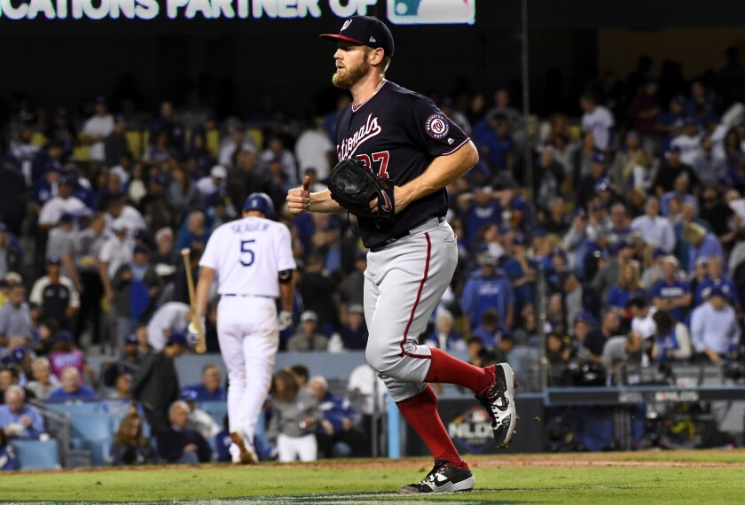 Washington Nationals pitcher Stephen Strasburg leaves the field after striking out Corey Seager during Game 2 of the NLDS on Friday.
