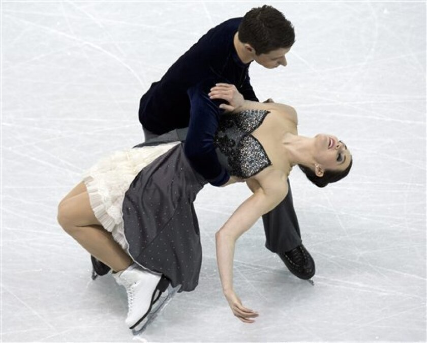 Tessa Virtue and Scott Moir, of Canada, perform in the ice dance short program at the World Figure Skating Championships in London, Ontario, on Thursday, March 14, 2013. (AP Photo/The Canadian Press, Frank Gunn)