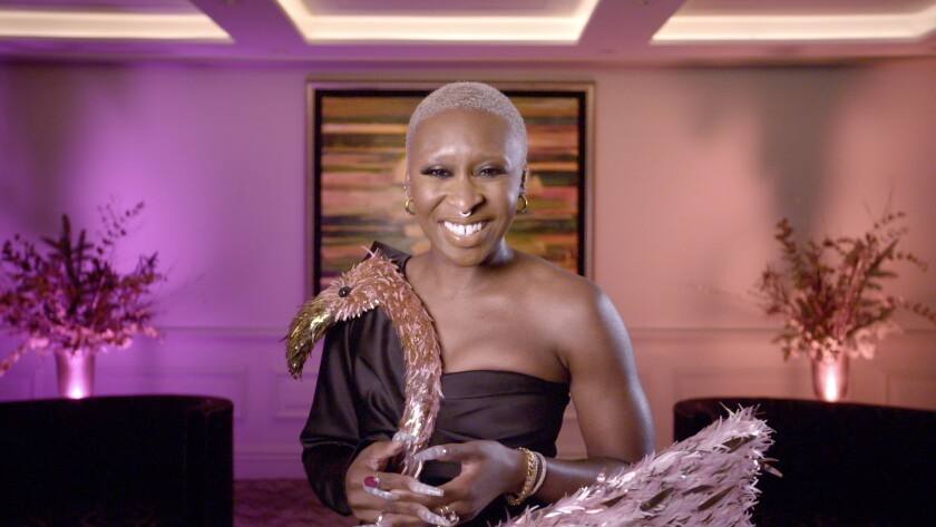 Cynthia Erivo wears a black dress with a flamingo on top of it