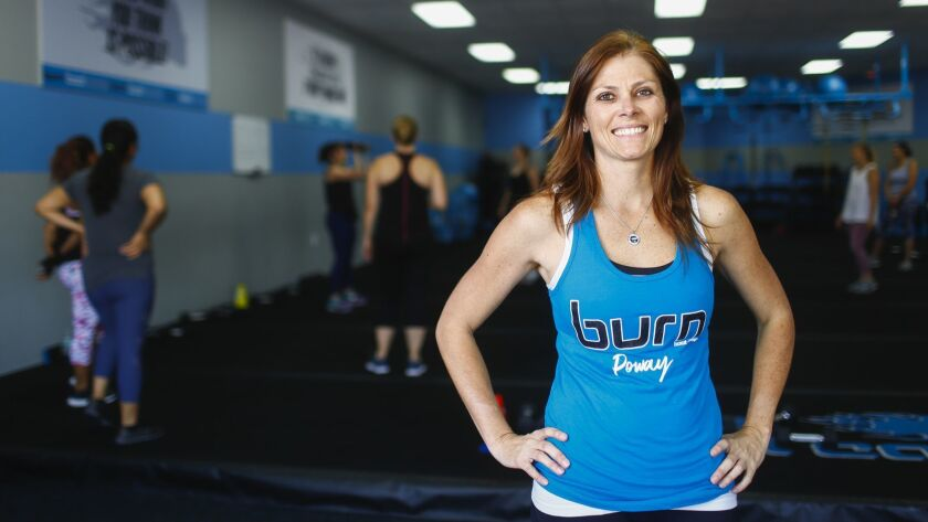 Jodi Lenhardt, owner of the Burn Boot Camp fitness facility in Poway, demonstrates workout activities and poses for portraits on Monday, June 18th, 2018.