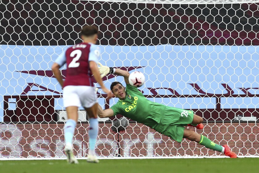 Aston Villa's goalkeeper Emiliano Martinez saves a penalty shot during the English Premier League soccer match between Aston Villa and Sheffield United at the Villa Park stadium in Birmingham, Monday, Sept. 21, 2020. (Clive Rose/Pool via AP)