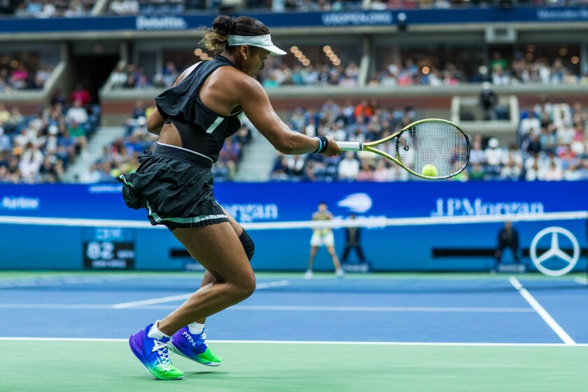 Naomi Osaka returns a shot during her loss to Belinda Bencic at the U.S. Open on Monday.