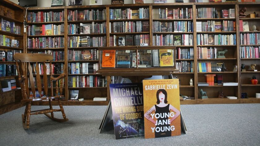 Various books past and present in the front room of Book Carnival in Orange. Owner Ann Saller makes
