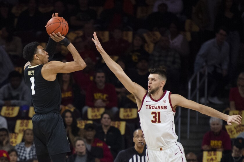 Colorado guard Tyler Bey shoots over USC forward Nick Rakocevic during the first half of a game Feb. 1 at Galen Center.