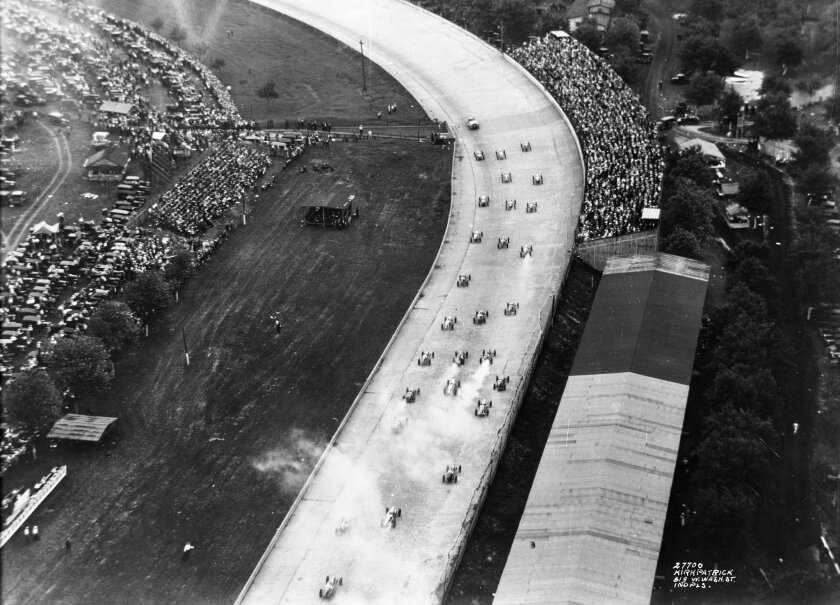 This May 31, 1926, photo provided by Indianapolis Motor Speedway show an aerial view of race cars heading into Turn 2 during the Indianapolis 500 auto race at Indianapolis Motor Speedway in Indianapolis, Ind. (IMS via AP)