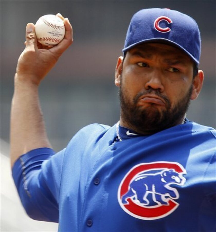 Chicago Cubs pitcher Carlos Silva throws in the first inning during a baseball game against the Pittsburgh Pirates in Pittsburgh Monday, June 7, 2010. (AP Photo/Gene J. Puskar)