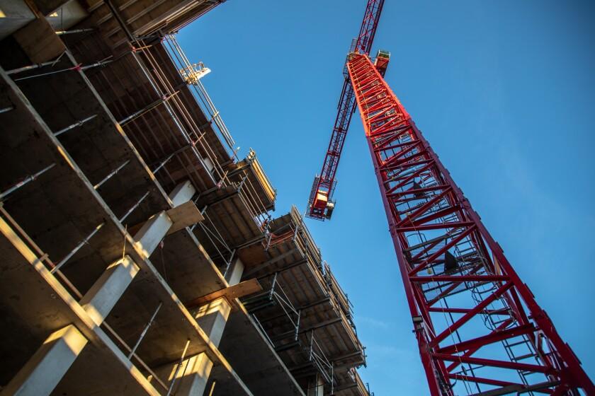 A crane at a housing construction site.