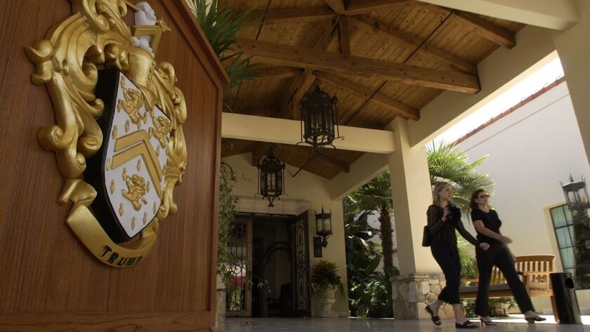 Visitors walked past the front entrance of the Trump National Golf Club -- Los Angeles. A measure will appear on the November ballot in Rancho Palos Verdes requiring raises and panic buttons for workers at the club and at the nearby Terranea resort.