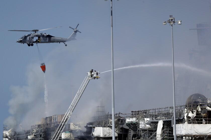 Fire crews battle the fire on the USS Bonhomme Richard on July 13