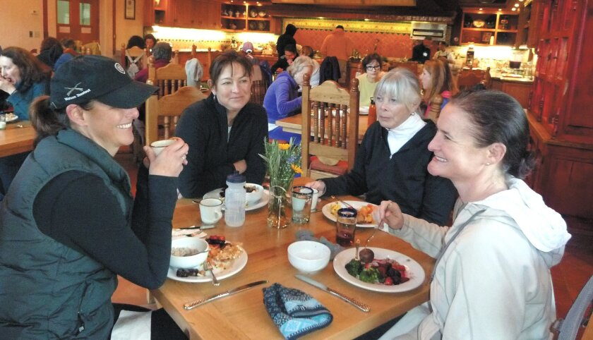 Dorie Smith, 72, (second from right) has breakfast with her daughters after an early morning hike to La Cocina Que Canta, the Rancho La Puerta cooking school.