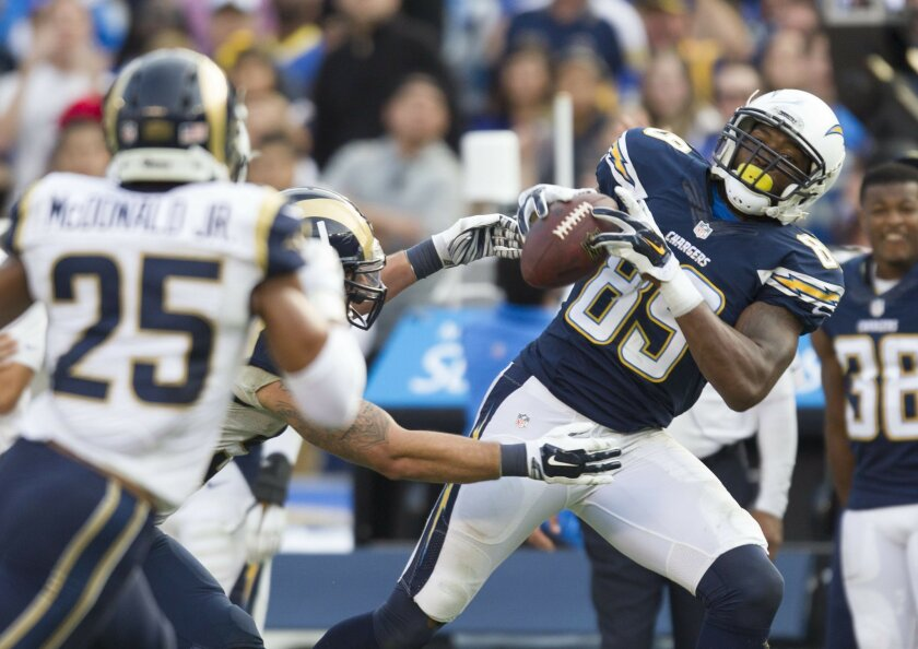 The San Diego Chargers vs. The St. Louis Rams at Qualcomm Stadium.San Diego Chargers tight end Ladarius Green (89) hauls in this fourth quarter pass.