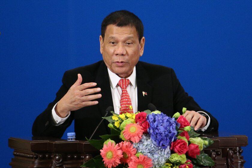 Philippine President Rodrigo Duterte makes a speech during the Philippines-China Trade and Investment Forum in Beijing on Thursday.