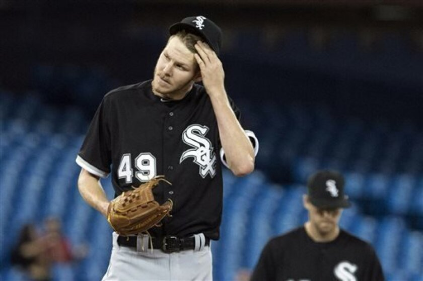 Chicago White Sox pitcher Chris Sale reacts during the fifth inning of a baseball game against the Toronto Blue Jays, Thursday, April 18, 2013, in Toronto. (AP Photo/The Canadian Press, Chris Young)
