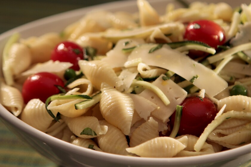 A shell pasta salad with lemon zest is popular at Wolfe's Market in Claremont. Read the recipe »