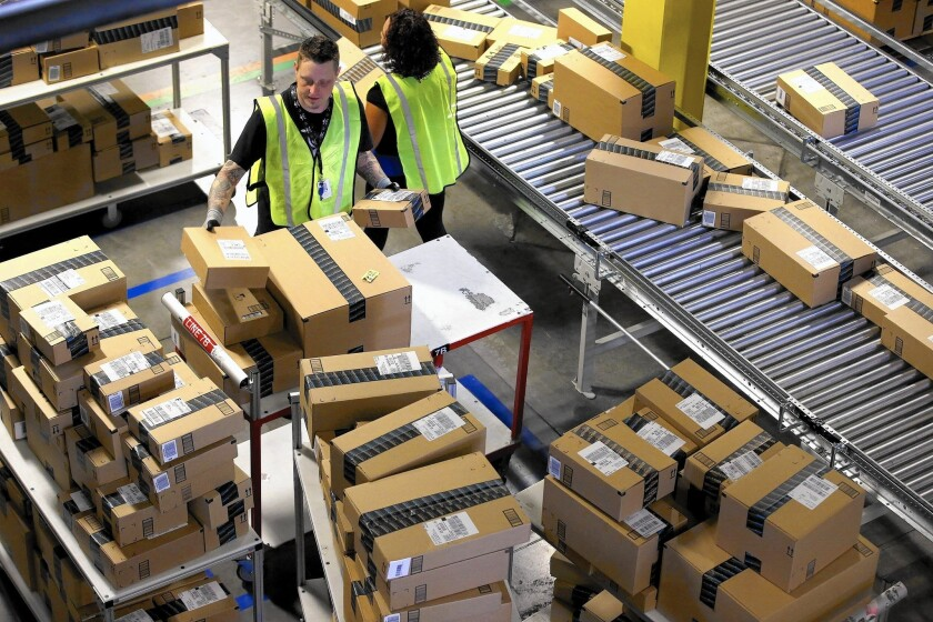 Amazon's first fulfillment center in California opened in 2012 in San Bernardino, a facility that has 1,500 employees today. Above, employees organize outbound packages at the facility in 2013.