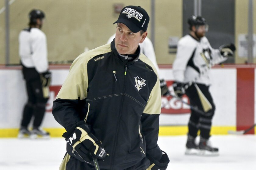 Pittsburgh Penguins head coach Mike Sullivan skates with the team during NHL hockey practice at the UPMC Lemieux Sports Complex, Saturday, May 28, 2016, in Cranberry, Pa. The Penguins host the San Jose Sharks in Game 1 of the Stanley Cup Finals on Monday, May 30. Mike Sullivan wasn't Rutherford's f