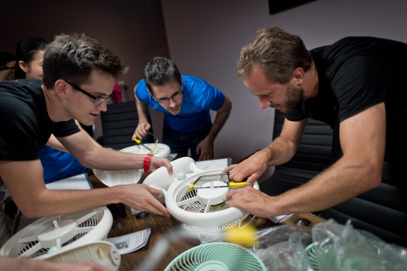 Thomas Talhelm, center, led workshops in Beijing to demonstrate how to make a simple, DIY air purifier.