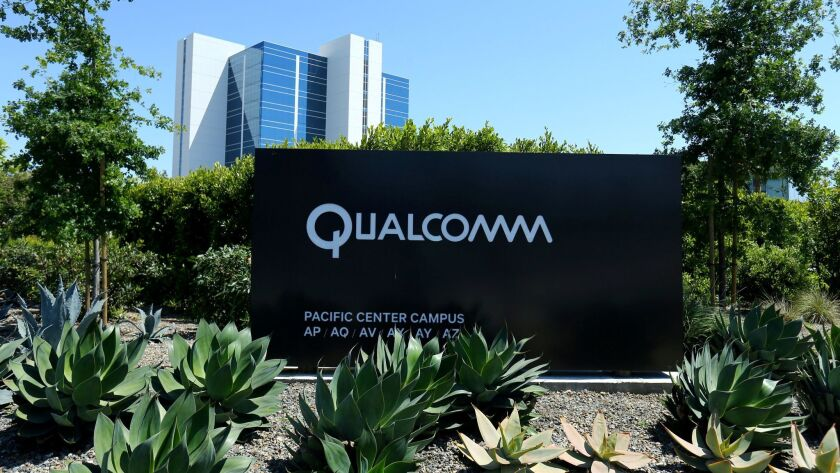 FILE PHOTO: A Qualcomm sign is pictured at one of its many campus buildings in San Diego