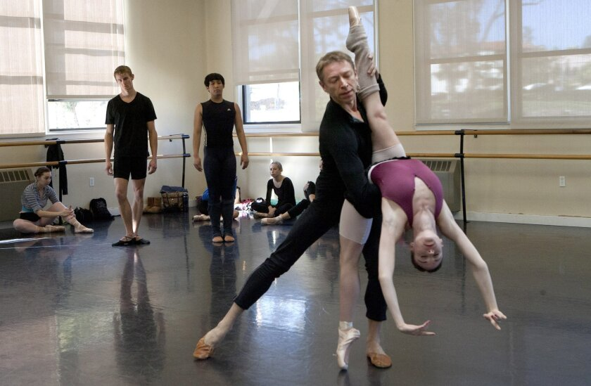 "Max Tchernychev, center, dances with Stephanie Maiorano, during a rehearsal of San Diego Ballet's ""Don Juan."""