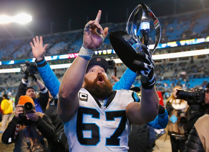 Carolina offensive lineman Ryan Kalil holds the George Halas Trophy while celebrating the Panthers' victory over Arizona in the NFC championship game last season.