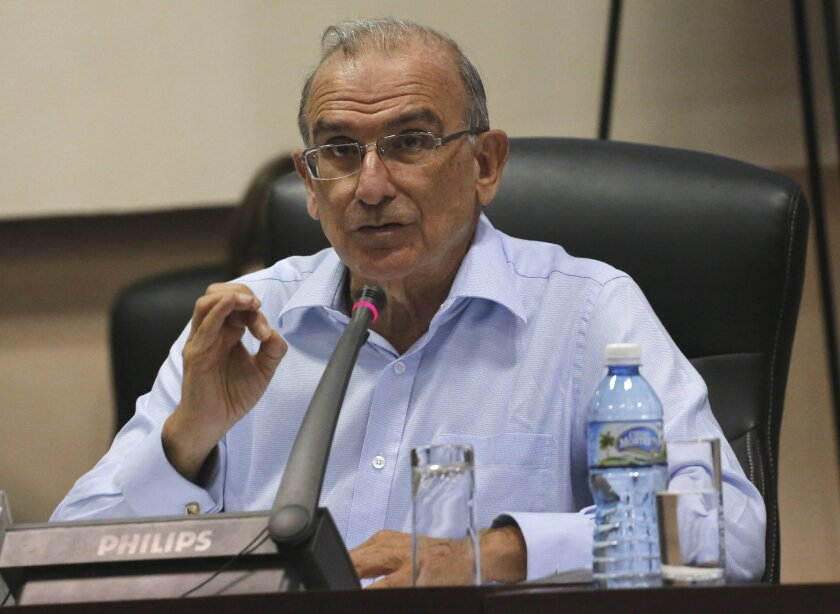 FILE - In this Jan. 19, 2016 file photo, Humberto de la Calle, head of Colombia's government peace negotiation team, speaks after a joint announcement with the Revolutionary Armed Forces of Colombia, in Havana, Cuba. Colombia on Thursday, feb. 18, 2016, suspended permits for rebel leaders negotiati