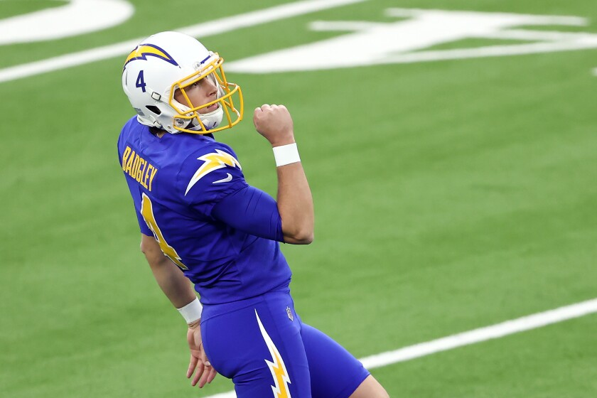 Michael Badgley of the Chargers celebrates after kicking the winning field goal as time expires Sunday against the Falcons.