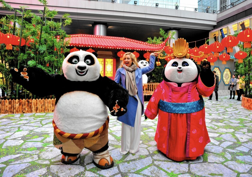 """Kung Fu Panda 3"" is projected to become a global hit for DreamWorks Animation. Above, actress Kate Hudson and characters Po and Mei Mei promote the film in China last week."